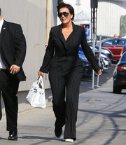 Kris Jenner was spotted making her way to 'Jimmy Kimmel' wearing a classic black pinstriped jumpsuit.
