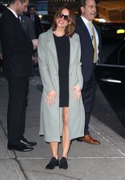 Aubrey Plaza teamed black suede oxfords with a wool coat and a mini dress for her visit to 'Stephen Colbert.'