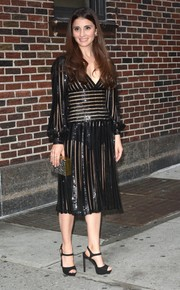 Shiri Appleby teamed her sultry dress with black ankle-strap platform sandals.