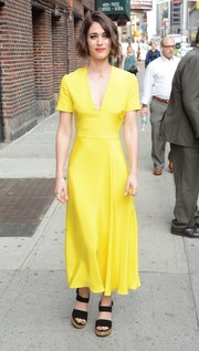 Lizzy Caplan arrived for her 'Stephen Colbert' appearance looking bright in a canary-yellow Roksanda dress.