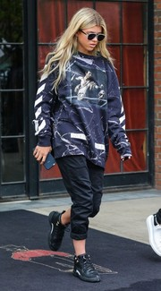 Sofia Richie stepped out of the Bowery Hotel wearing a pair of sporty pants and a baggy sweatshirt.