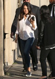 Mila Kunis went for funky styling with a pair of printed canvas shoes.