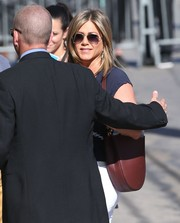 Jennifer Aniston arrived for her 'Jimmy Kimmel' appearance carrying a burgundy leather shoulder bag by Celine.