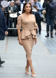Eva Longoria looked picture-perfect in a nude peplum dress by Julea Domani while making an appearance on 'The View.'