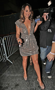 Cheryl Burke perfectly complemented her metallic leopard print dress with nude peeptoe platforms.
