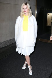 Alice Eve bundled up in a white cape with geometric piping as she headed to the 'Today Show.'