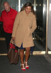 Mindy Kaling departed the NBC Studios after her 'Today Show' appearance wearing a stylish beige wool coat.