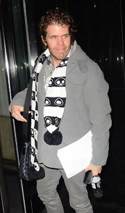 Trust Perez Hilton to add something quirky to any ensemble, like this alien-print pompom scarf.