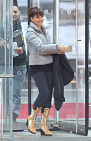 "Sofa Vergara filmed scenes for ""New Year's Eve"" in tan lace up wedge boots."