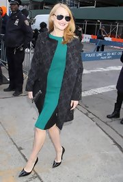 Patricia Clarkson opted to keep her look classic and sophisticated with a floral evening coat.