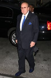 Clive Davis looked sleek and dapper in this pinstriped suit and electric blue tie.
