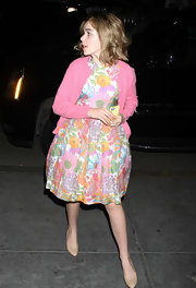 Kiernan Shipka teamed her feminine floral dress with a sweet pink cardigan.