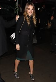 Jessica Alba paired her cute cocktail dress with a stylish zip-up wool jacket for an ultra sleek and modern look.