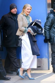 Cameron Diaz completed her street-chic outfit with white wide-leg capris.