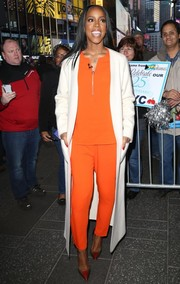 Kelly Rowland was spotted outside the 'Good Morning America' studio wearing a bright orange half-zip blouse.