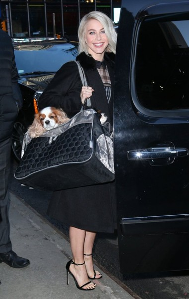 Julianne Hough left the 'Good Morning America' studios carrying her dog in a black and silver duffle.