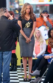 Tyra wore a grey pencil skirt for her appearance on 'Good Morning America'.