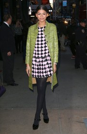 A green Karolyn Pho coat added a touch of classic elegance to Zendaya Coleman's mini.
