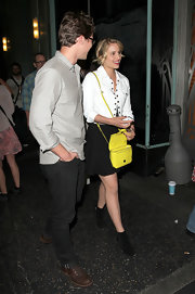 Dianna Agron attended a Jack White concert in this brilliant white jacket with gold buttons.