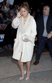 Jennifer Lopez matched her white coat and dress combo with a pair of Christian Louboutin mesh pumps.