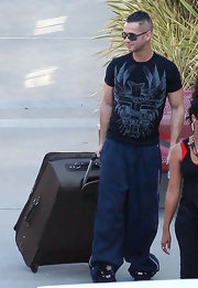 "Mike Sorrentino, better known as ""The Situation,"" sports baggy track pants on the way to practice for 'Dancing with the Stars.' We hope he doesn't trip on all that extra fabric!"