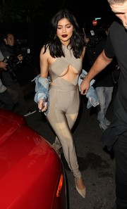 Kylie Jenner gave us an eyeful of cleavage in this skintight nude cutout jumpsuit by House of CB as she headed to Nice Guy restaurant.