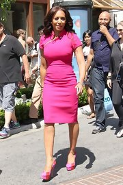 "Melanie Brown's hot pink sheath dress showed off her fit figure at the 'Extra!"" studios."