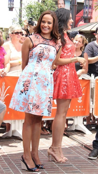 Judy's pale blue and coral floral dress mixed a retro silhouette with a contemporary print for a super chic look.