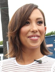 Cheryl Burke appeared on 'Extra' rocking a flip hairstyle.