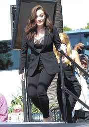 Kat Dennings made an appearance on 'Extra' wearing a black pantsuit with a lace-trimmed cami.