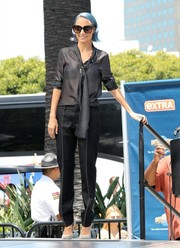 Nicole Richie stopped by 'Extra' wearing a casual yet sophisticated pinstripe tie-neck blouse.