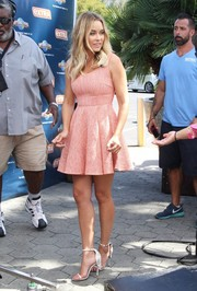 Lauren Conrad looked ultra girly in a pink skater dress while visiting 'Extra.'