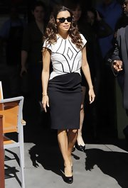 Eva Longoria chose a black-and-white leather dress with a cool geometric design on the bodice for her look on 'Extra.'