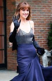 Dakota Johnson headed to the Met Gala carrying a geometric black hard-case clutch by Lee Savage.
