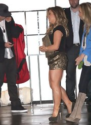 Shawn Johnson amped up the glitz factor with a pair of sparkly platform pumps and metallic gold shorts.