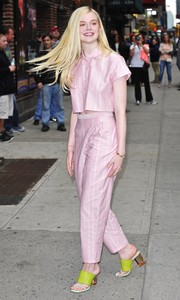 Elle Fanning was in a matchy-matchy mood, completing her look with striped pink slacks.