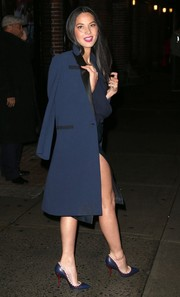 Olivia Munn left the 'Letterman' studio looking smart in a navy coat with black satin lapels.