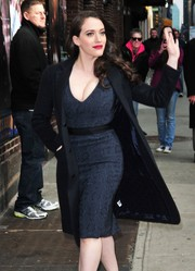 Kat Dennings made her way to the 'Letterman' studio wearing a black wool coat over a figure-hugging blue dress.