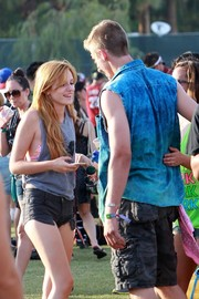 Bella Thorne flashed plenty of skin at Coachella in a tank top with oversize arm holes.