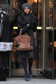 Tika epitomizes 'Gossip Girl' style in this leopard print beret and stylish winter ensemble.
