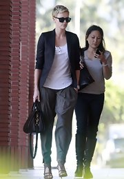 Charlize Theron dressed down these gray harem pants with a cool slouchy tee.