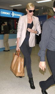 Charlize Theron looked polished at LAX carrying a tan Gucci Madison ostrich tote.
