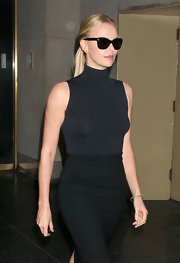 Charlize Theron made a case for minimalism in a sleek charcoal turtleneck and black knit pencil skirt.