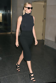 Charlize Theron streamlined her look with a tight charcoal pencil skirt.