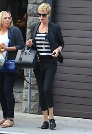 Charlize Theron chose a pair of classic black capri pants for her look at while out in LA.