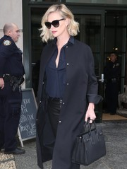 Charlize Theron headed out in New York City carrying a black Saint Laurent leather tote.