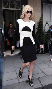 Charlize Theron loves a great black-and-white ensemble like this one.