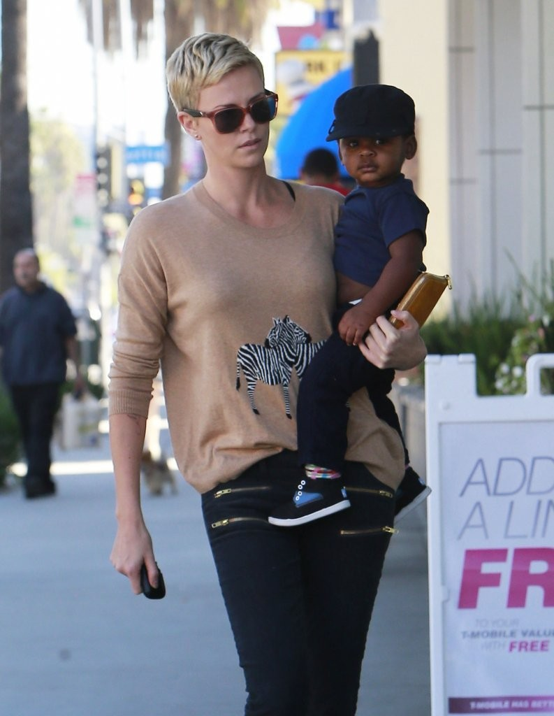 Charlize Theron Picks Up a Snack With Jackson