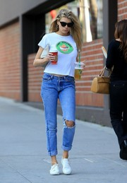 Charlotte McKinney injected some edge with a pair of ripped jeans.