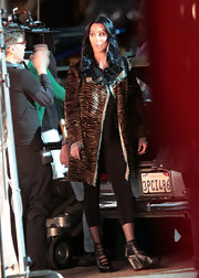 Cher's black cutout boots and tiger-print coat were a fierce pairing.
